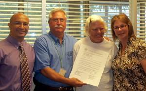 Galveston Walk to End Alzheimer's Team Meg holding proclamation