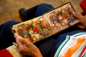 During the Holidays, involve persons with Alzheimer's with pictures of family.