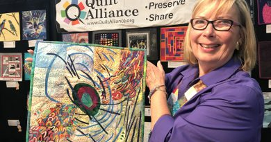 "Carol Poole at the Houston International Quilt Festival with her ""My Alzheimer's Voice"" Award winning quilt"